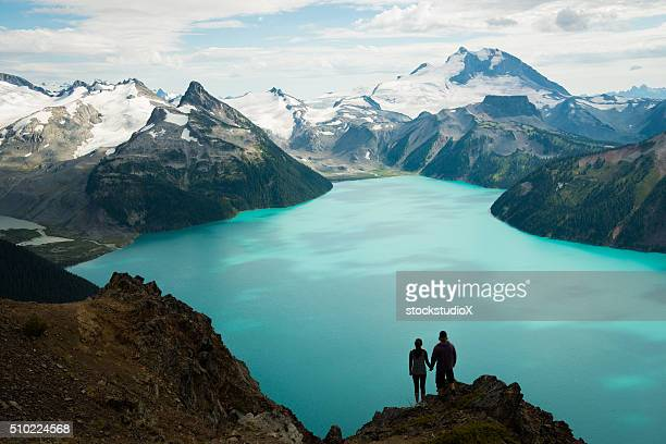 couple enjoying the beautiful outdoors - mountain range stock pictures, royalty-free photos & images