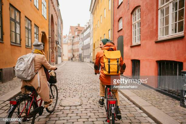 couple enjoying the city ride - denmark stock pictures, royalty-free photos & images