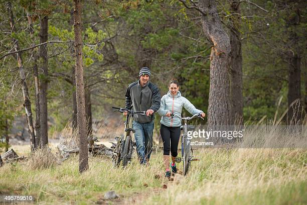 couple enjoying the outdoors on bikes - fat lady in leggings stock photos and pictures