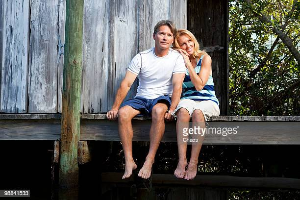 couple enjoying the scenery on a dock - newhealth stock photos and pictures