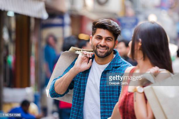 couple enjoying the weekend in the shopping mall stock photo - indian culture stock pictures, royalty-free photos & images