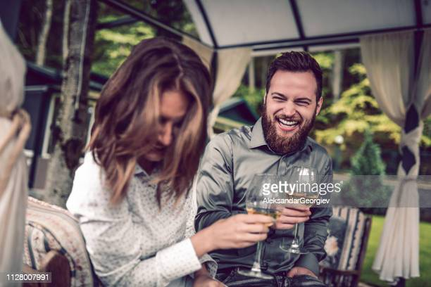 couple enjoying their anniversary party on balcony with champagne - drunk wife at party stock pictures, royalty-free photos & images