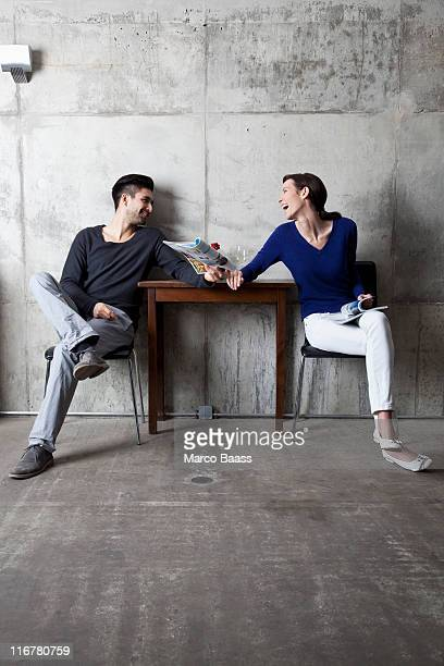 a couple enjoying themselves at cafe - mixed magazine stock photos and pictures