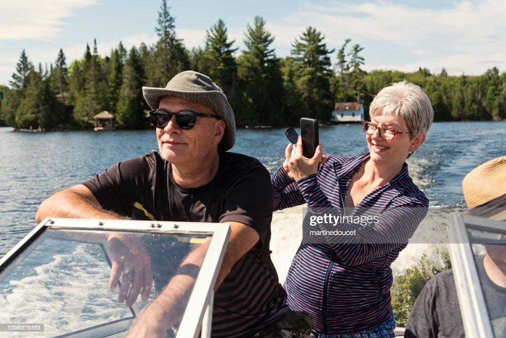 50+ couple enjoying vacations on a small boat. : Stock Photo