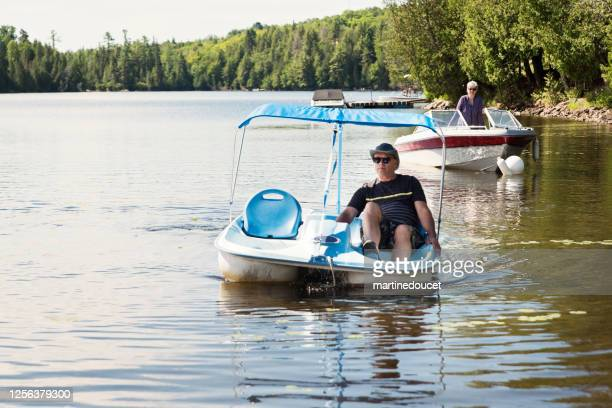 """50+ couple enjoying vacations on nautical vessel. - """"martine doucet"""" or martinedoucet stock pictures, royalty-free photos & images"""