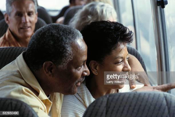 Couple Enjoying View from Bus Window