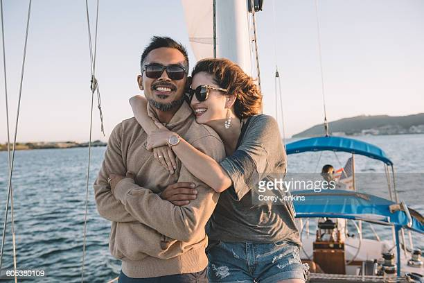 Couple enjoying view on sailboat, San Diego Bay, California, USA