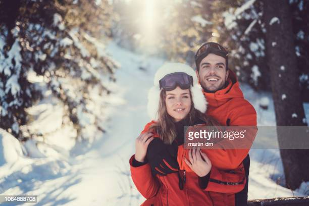 couple enjoying winter holiday together - ski wear stock pictures, royalty-free photos & images