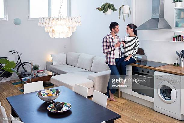 Couple enjoying with a glass of wine in their apartment