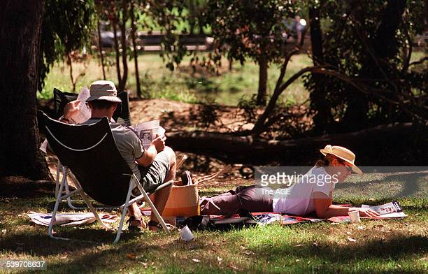 A couple enjoys a picnic at Hanging Rock 24 February 2002 THE AGE Picture by JAMES BODDINGTON