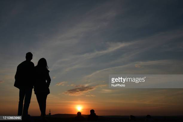Couple enjoys a sunset view from Krakus Mound in Krakow-Podgorze. Since the 20th of April, the ban on moving, traveling and staying in public places...