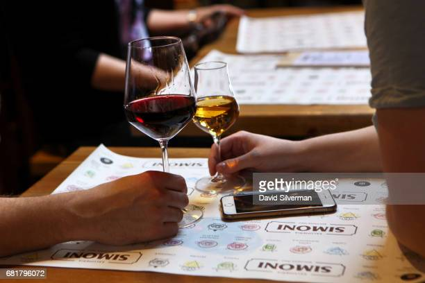 A couple enjoys glasses of wine at the Salumeria Simoni n the heart of the Quadrilatero market area on March 31 2017 in Bologna Italy The historic...