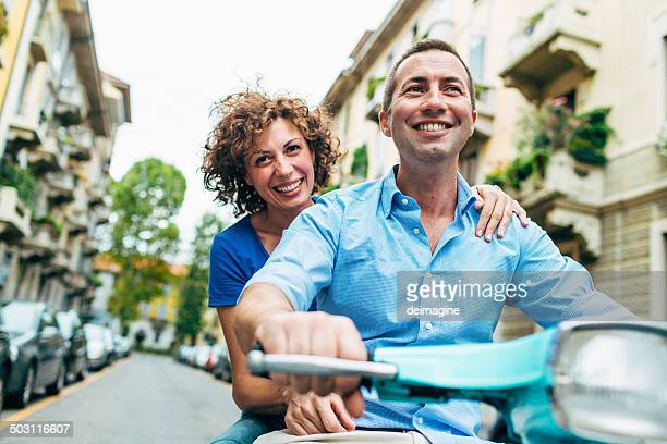 couple enjoys on a scooter - 30 39 years stock pictures, royalty-free photos & images