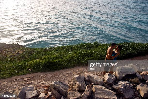 A couple enjoys the day on Varadero beach in the Cuban province of Matanzas taken on August 21 2010 AFP PHOTO/STR