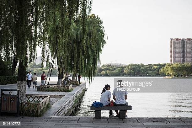 A couple enjoys the view at Daming Lake in Jinan Shandong province on June 17 2016 Jinan is also called the 'Spring City' for its wellknown water...