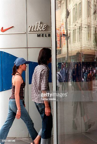 Couple entering Nike store in melbourne
