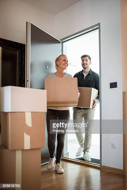 Couple entering their new apartment