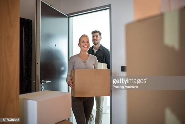 Couple entering their new condo
