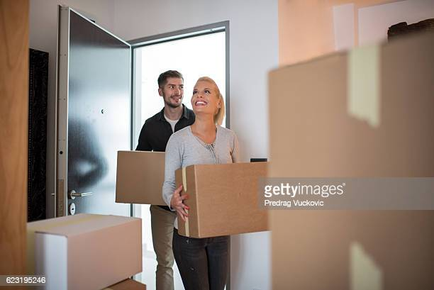 Couple entering their new home