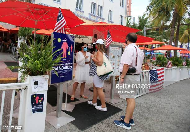 A couple enters the Oceans Ten restaurant on Ocean Drive on July 04 2020 in the South Beach neighborhood of Miami Beach Florida In order to prevent...