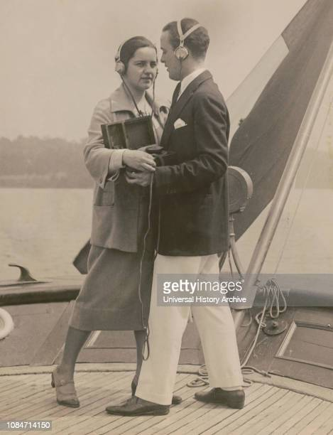 Couple Equipped with Portable Radio and Headphones Dancing to Broadcasted Fox Trot while making the Trip to Albany New York on Senator Guglielmo...