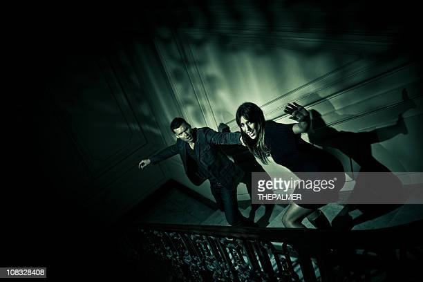 couple escaping from evil - escapism stock photos and pictures