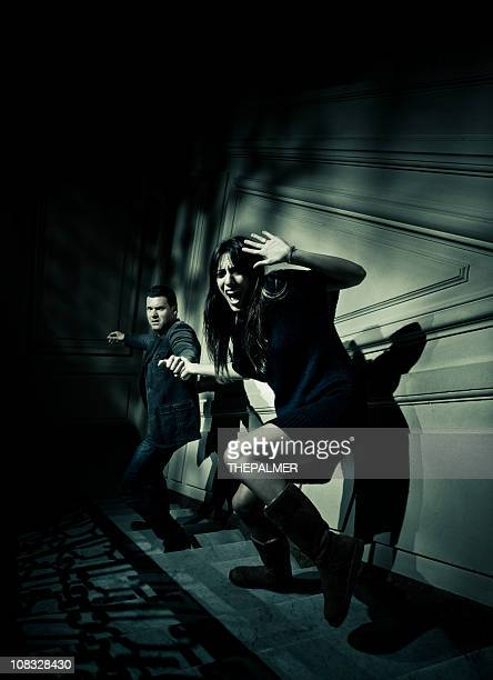 couple escaping from something evil - film noir style stock pictures, royalty-free photos & images
