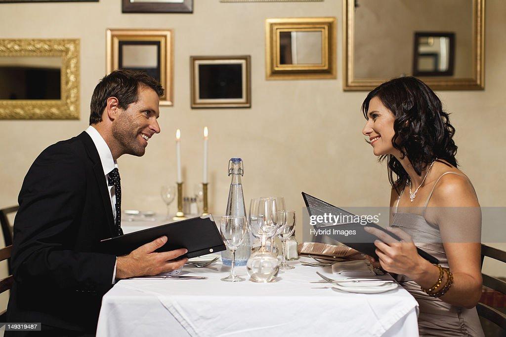 Couple examining menus in restaurant : Stock-Foto