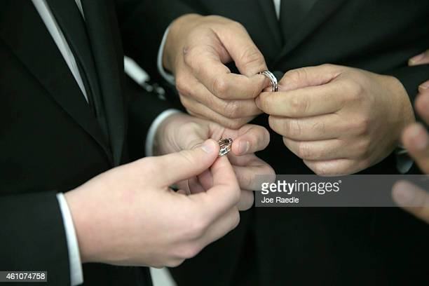 A couple exchange rings as they are wed during a wedding ceremony at the Broward County Courthouse on January 6 2015 in Fort Lauderdale Florida Gay...