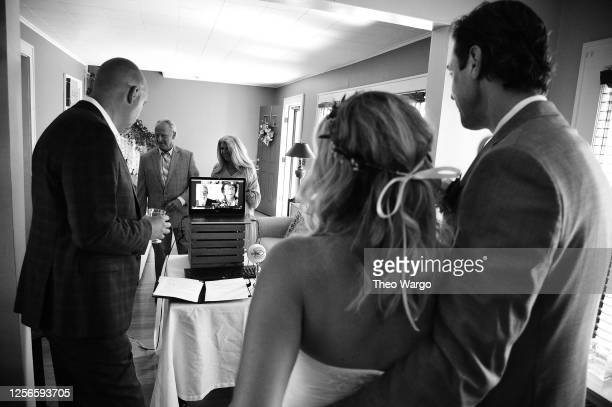 Couple exchanges vows on June 07, 2020 in Morris Plains, New Jersey. Virtual weddings have been on the rise amid the Coronavirus which elevated to a...