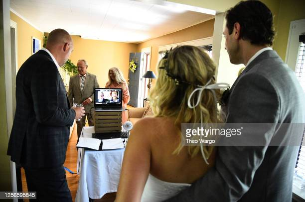 Couple exchanges vows on June 07, 2020 in Morris Plains, New Jersey. Virtual weddings have been on the rise amid the Coronavirus pandemic which...