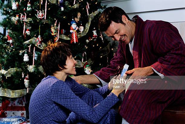 Couple Exchanging Gifts on Christmas