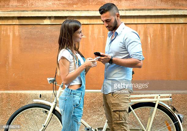 Couple Exchanging their Telephone Numbers