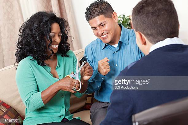 Couple excited about cutting up credit card in financial meeting