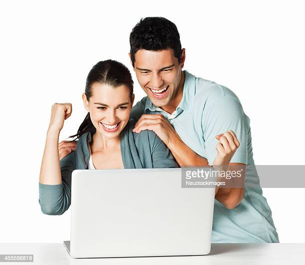 Couple Excited at the Computer - Isolated