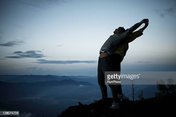 couple exercising at the mountain