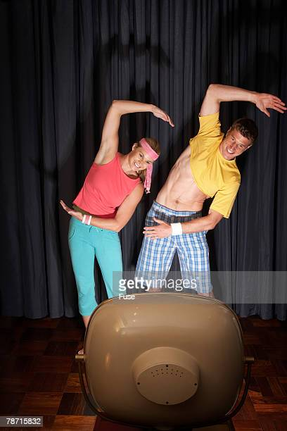 Couple Exercising in Front of Television