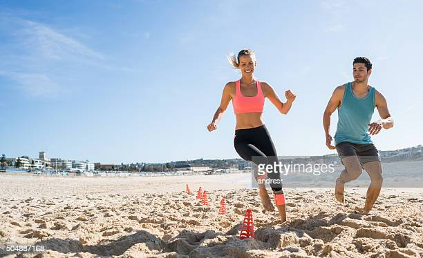 Couple exercising outdoors at the beach