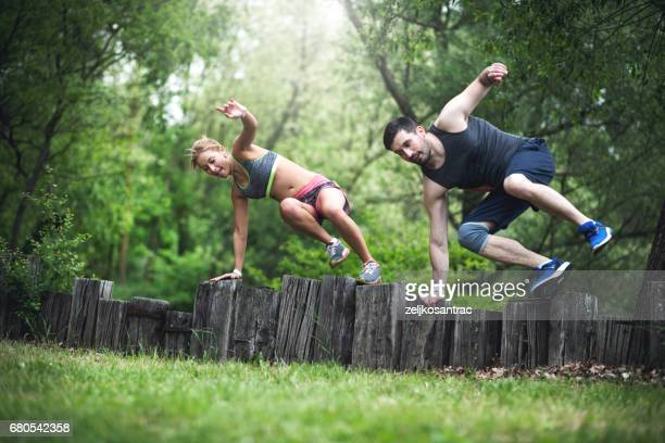 couple exercising outdoors - spring racing stock photos and pictures