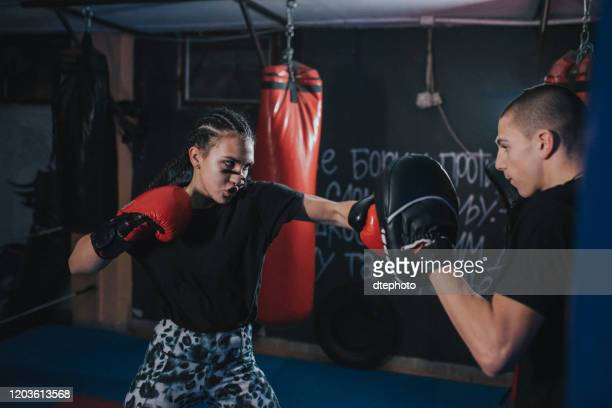 couple exercising punching - women's boxing stock pictures, royalty-free photos & images