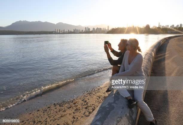 Couple explore waterfront area of city, sunrise