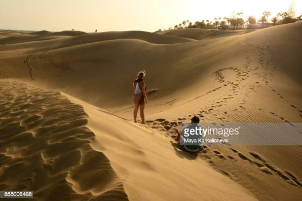 Couple exploring Maspalomas sand dunes, Canary islands