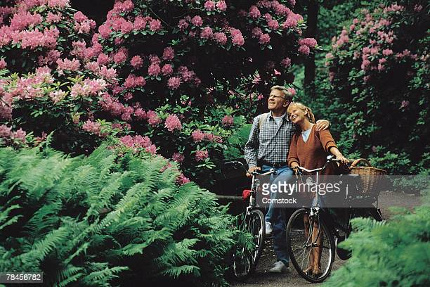 Couple exploring park or arboretum with bicycles