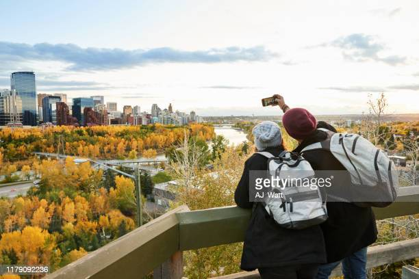 a couple exploring the city - calgary alberta stock pictures, royalty-free photos & images