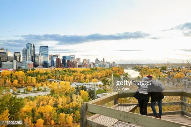 a couple exploring the city - calgary stock pictures, royalty-free photos & images