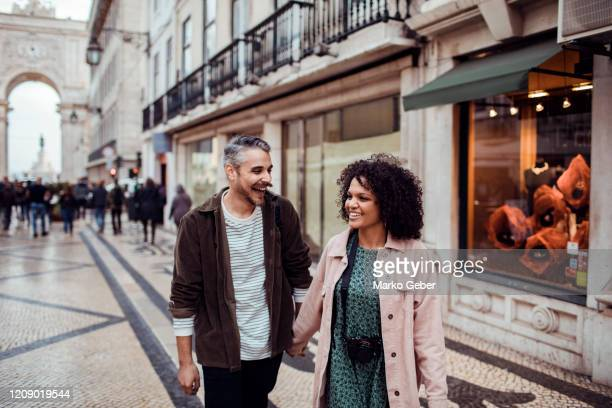 couple exploring the city - portugal stock pictures, royalty-free photos & images