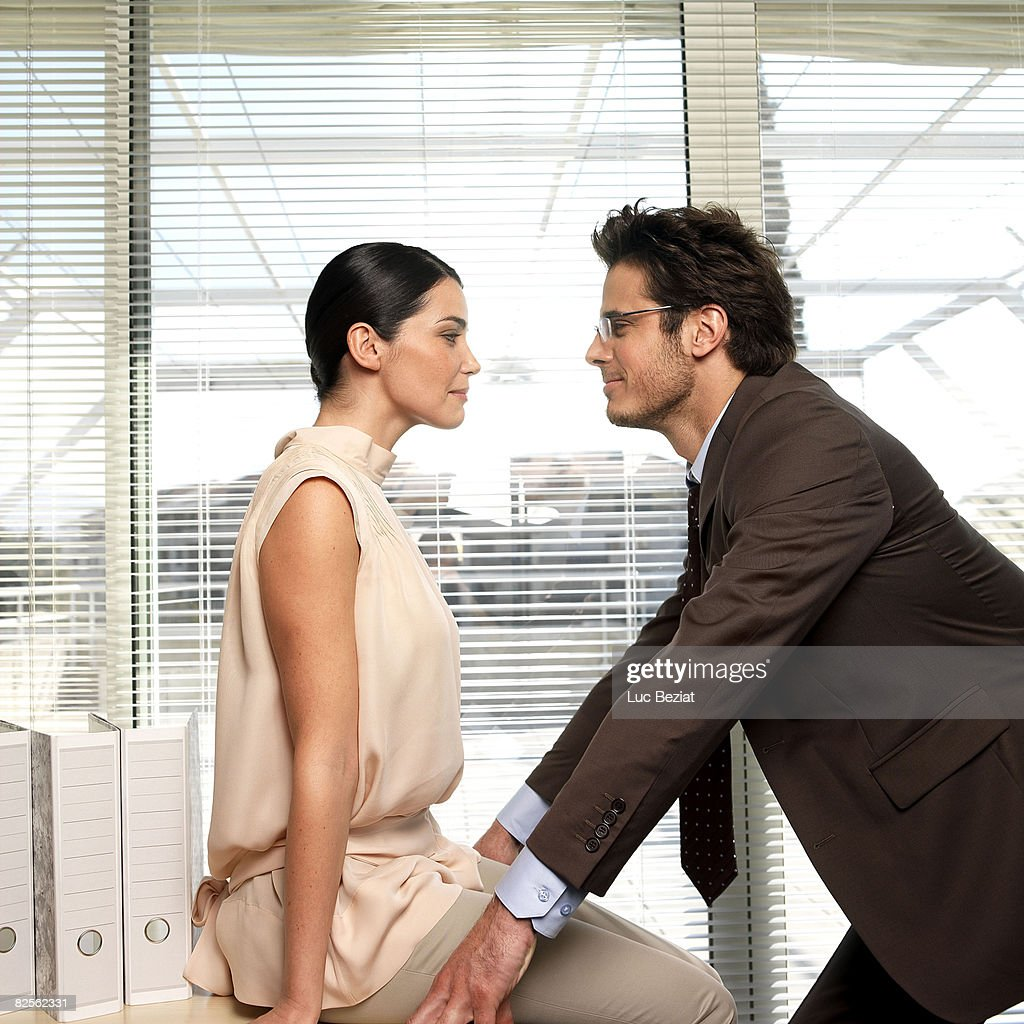 Couple facing each other in office : Stock Photo