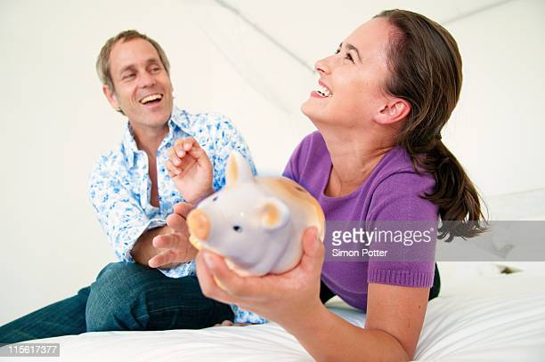 Couple fight over piggy bank