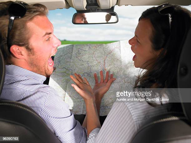 couple fighting in car