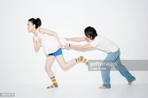 Couple fighting over pillow
